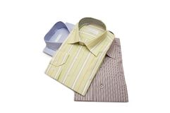 Three striped shirts isolated. On the white Stock Photography