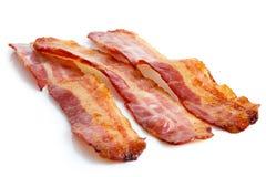 Three strips of fried crispy bacon. Royalty Free Stock Photo