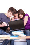 Three  student studying  on laptops Royalty Free Stock Photography