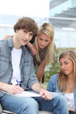 Three students. Outside their college Royalty Free Stock Photo