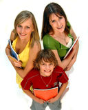 Three students. Three happy kids with school supplies on a white background