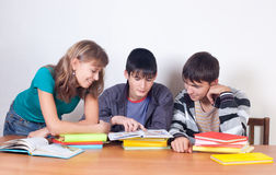 Three students with books Stock Images