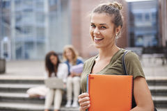 Three students on campus Stock Images