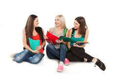 Three students girl with copybooks sitting Royalty Free Stock Photo