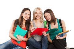 Three students girl with copybooks sitting Stock Photography