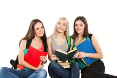 Three students girl with copybooks sitting Royalty Free Stock Images
