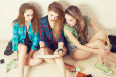 Three Students Girls Sitting on the Floor Royalty Free Stock Image