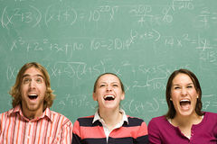 Three students laughing Royalty Free Stock Photography
