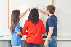 Three students learn math Royalty Free Stock Photo