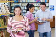 Three students in library. Three happy students in library Stock Image