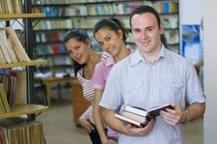 Three students in library Stock Image