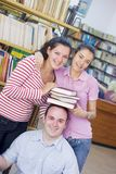 Three students in library Stock Images