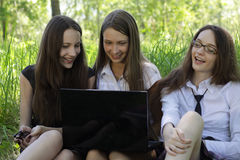 Three students with notebook in the park Royalty Free Stock Images