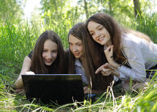 Three students with notebook in the park Stock Image