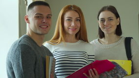 Three students pose at the college stock video footage