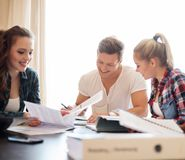 Three students preparing for exams Stock Photos