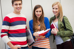 Three students standing together Royalty Free Stock Photo