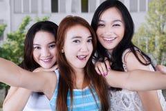Three students taking photo at school Stock Photos