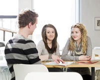Three students talking Stock Photos
