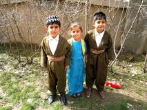 Three students. Three teen students wearing a traditional kurdish clothes at 8th of march in kurdistan royalty free stock image