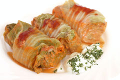 Three stuffed cabbage with sour cream on a white Stock Images