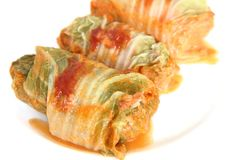 Three stuffed cabbage with tomato sauce on a white Royalty Free Stock Image