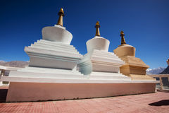 Three stupa and blue sky at Diskit monastery, Ladakh, India Stock Photo