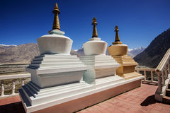 Three stupa and blue sky at Diskit monastery, Ladakh, India Stock Image