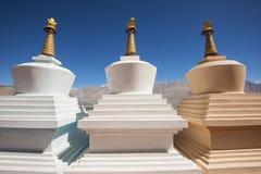 Three stupa and blue sky at Diskit monastery, Ladakh, India Stock Images