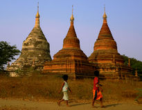 Three Stupas & Two Kids Myanmar (Burma). Three Stupas & Two Kids. Bagan Archaeological Zone, Heritage Site. Myanmar (Burma stock image