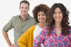 Three stylish friends standing in a row Royalty Free Stock Photography