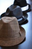 Three Stylish Hats On Table Royalty Free Stock Photos