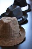 Three Stylish Hats On Table. Three stylish dress hats on a table Royalty Free Stock Photos
