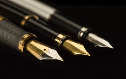 Three stylish ink pens for the letter. I Royalty Free Stock Photos