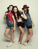 Three stylish sexy hipster girls best friends Stock Images
