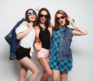 Three stylish sexy hipster girls best friends Stock Photos