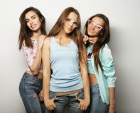 Three stylish sexy hipster girls best friends. Over white background Stock Image