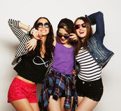 Three stylish sexy hipster girls best friends. Stock Photos