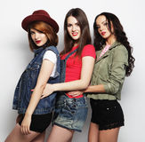Three stylish hipster girls best friends. Royalty Free Stock Images