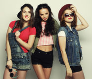 Three stylish sexy hipster girls best friends. Royalty Free Stock Photo