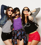Three stylish sexy hipster girls best friends. Royalty Free Stock Photos