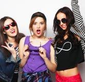 Three stylish sexy hipster girls best friends. Royalty Free Stock Photo