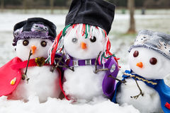 Three stylish snowmen dressed beautifully Stock Image