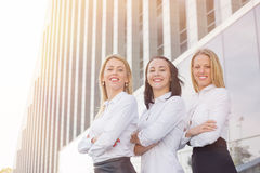 Three succesful women standing with their hands crossed Stock Photos