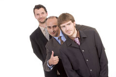 Three successful business men, with thumb up. Three successful business men, one of them with thumb up (isolated on white Stock Image