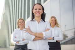 Three successful business women. Standing and smiling Royalty Free Stock Photos