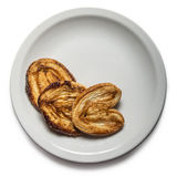 Three sugared cookies. On a white plate with space for your text royalty free stock photography