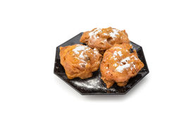 Three sugared fried fritters or oliebollen on saucer Stock Images