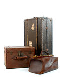 Three suit-cases. Isolated group of suit-cases Stock Photo
