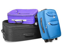 Three Suitcases. Three full and closed suitcases, black, blue and violet, ready for the trip, isolated on white background Stock Photos